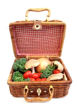 basket with vegetables in it over white photo