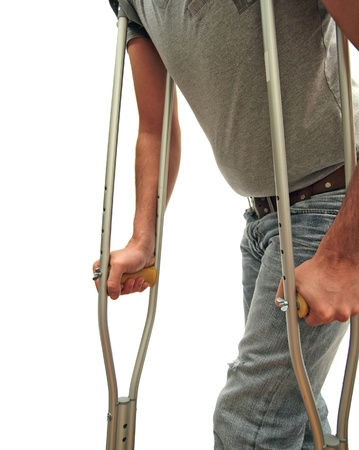 closeup of a man walking with crutches