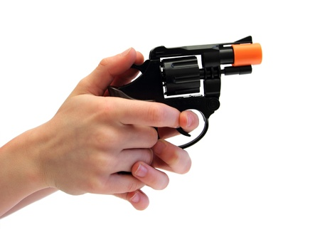 closeup of a kid hands holding a plastic gun over white
