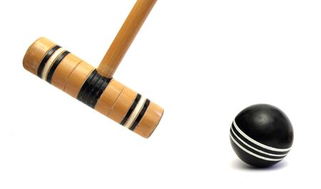 croquet mallet and ball over white Standard-Bild