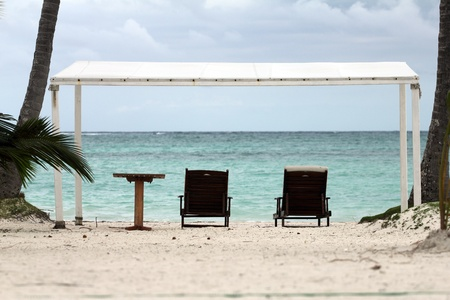 image of two chairs and a table on a beach Stock Photo - 12597506