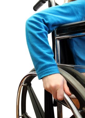 enfants handicap�s: Gros plan sur un enfant dans une chaise roulante Banque d'images