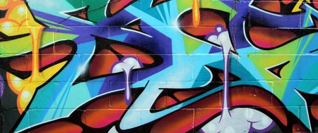 colorful brick wall graffiti taken on the street