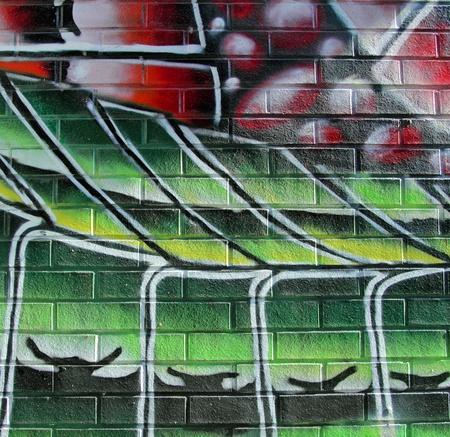 colorful brick wall graffiti taken on the street