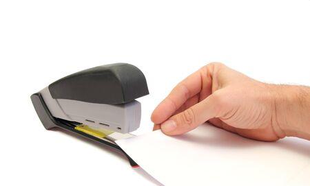 office stapler: hand sheets and stapler over white Stock Photo