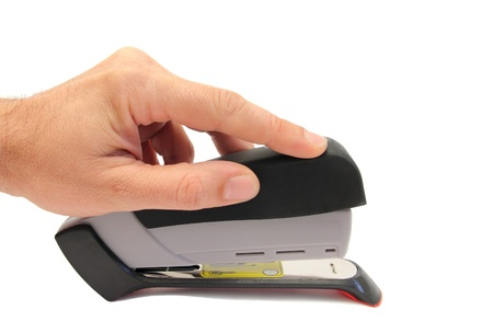 hand pressing an office stapler Stock Photo - 13363290