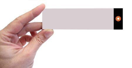 closeup of a hand presenting a sales tag Stock fotó