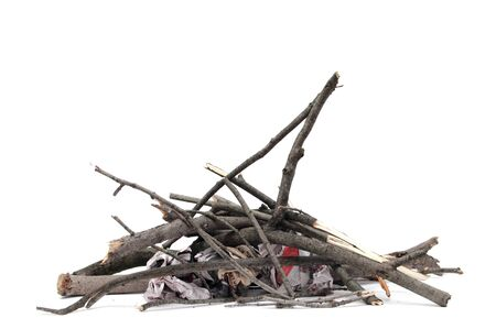 making a fire: pile of wood branches over white