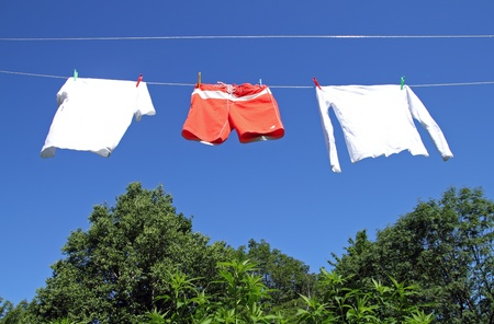 colorful clothesline over blue sky photo