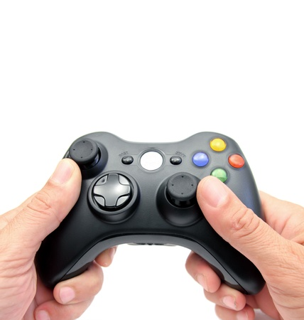 closeup of two hands holding a videogame controller Stok Fotoğraf - 14604709