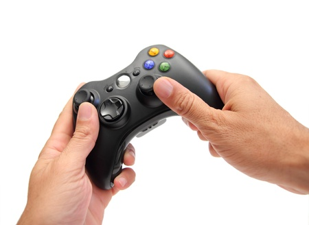 closeup of two hands holding a videogame controller Stok Fotoğraf - 14604710