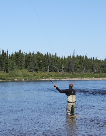 image of a fly fisherman in action photo