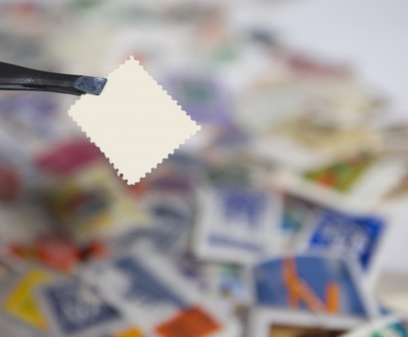 closeup of a blank stamp over a pile of stamps