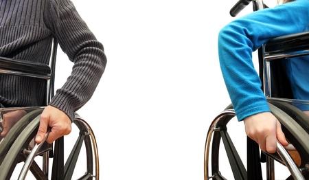 handicap people: Primer plano de un hombre y un ni�o en silla de ruedas cada uno por su lado
