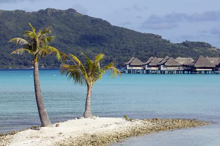 over water bungalows on the lagoon photo