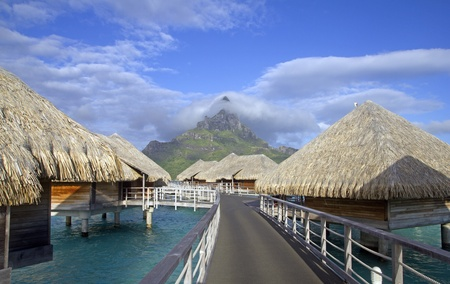 polynesia: bora bora otemanu mountain with lagoon bungalows and blue sky