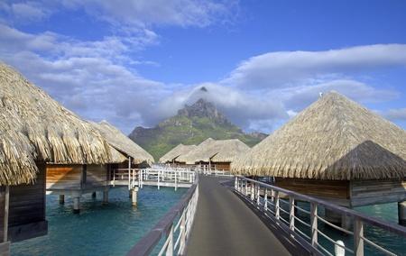 otemanu: bora bora otemanu mountain with lagoon bungalows and blue sky
