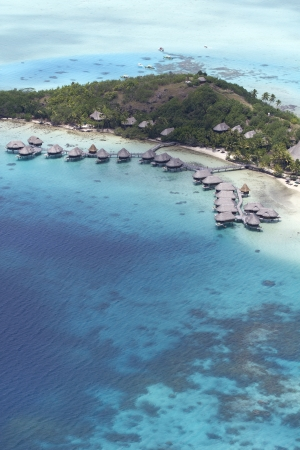 aerial view of over water bungalows and the island of bora bora