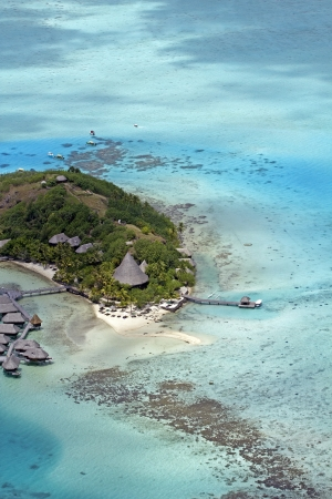 aerial view of over water bungalows and the island of bora bora photo
