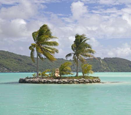 motu: little statue on a small lagoon island Stock Photo