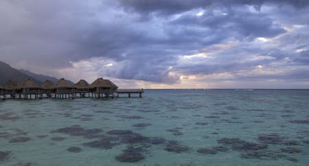 sunset in a resort in french polynesia Editorial