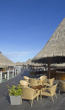 polynesia: over water restaurant on a pier in french polynesia