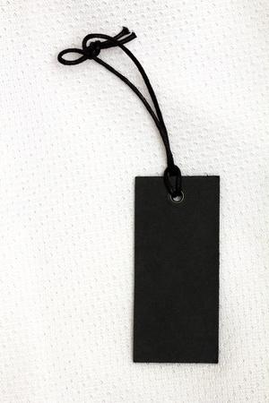 black price tag over white tissue Foto de archivo