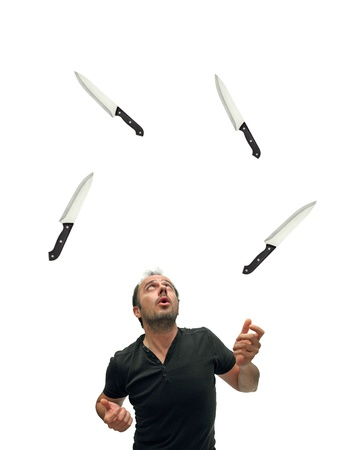 juggler using knives over white