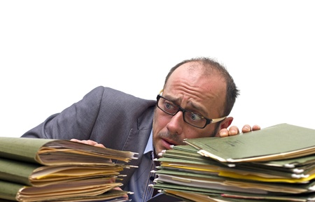 exhausted man looking at piles of folders