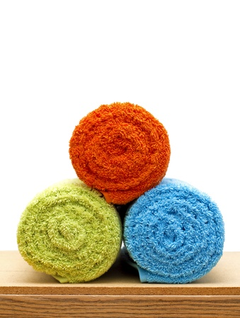 closeup of colorful rolled towels