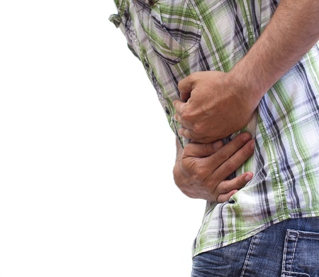 closeup of a man with stomach cramps Stock Photo
