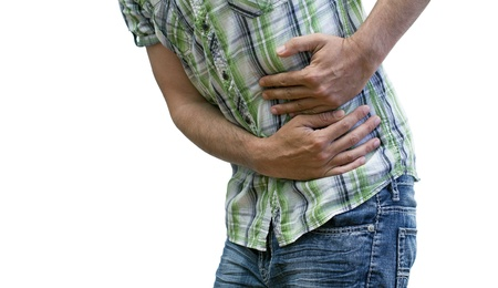 closeup of a man with stomach cramps photo