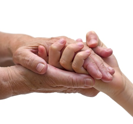 hands holding: old woman hands holding the hand of a kid Stock Photo