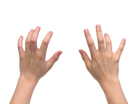 hands of a kid typing over white
