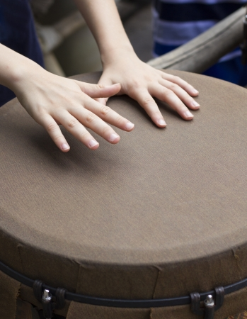 bongo drum: closeup of kid hands playing bongo