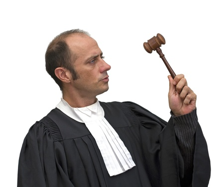 accusing: judge with uniform over a white background  Stock Photo