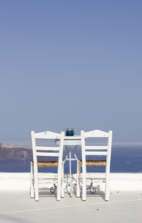 little table: two chairs and a little table facing the sea on a terrace