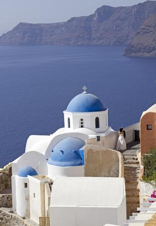image of a wedding by a classical church on santorini island greece photo