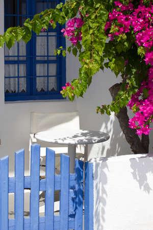 image of a colorful little terrace in santorini greece photo