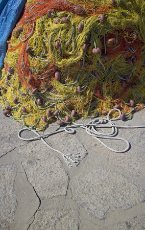 closeup of a colorful fishing net on the pier of naoussa greece photo