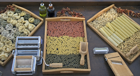 diferent: wood table with diferent kind of pastas on it