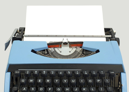 old blue typewriter isolated