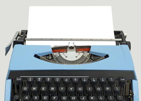 old blue typewriter isolated