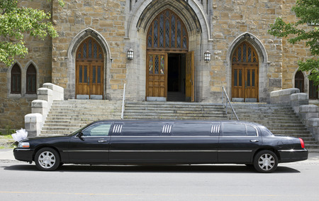black limo in front of a church