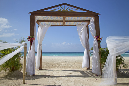 cabana: wedding arch and set up on beach Stock Photo