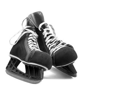 skating: black leather ice skates isolated on white