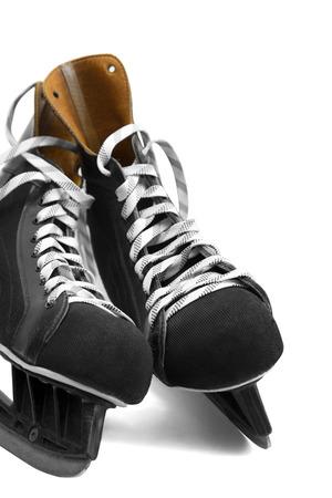 black leather ice skates isolated on white photo