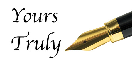 Yours truly message written with golden fountain pen Standard-Bild