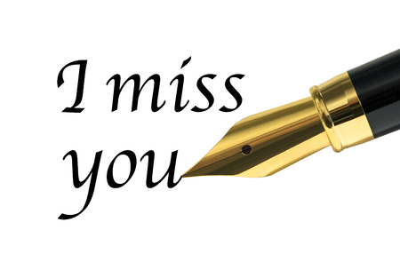 i miss you: I miss you message written with golden fountain pen Stock Photo