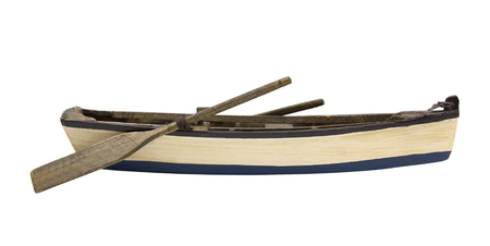 Isolated wooden boat with paddles Imagens
